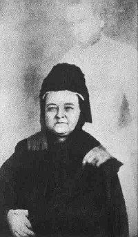 """""""Снимка на дух"""", на която уж е запечатан призракът на Ейбрахам Линкълн до съпругата си Мери Линкълн, направена от Уилям Мамлер (1869)."""