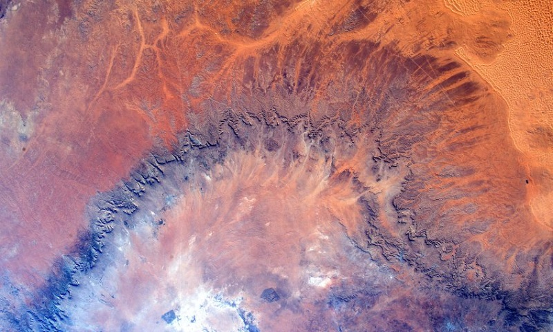 """ESA astronaut Tim Peake took this image from the International Space Station during his six-month Principia mission. He commented: """"I love orbiting over Africa - it is like flying over a canvas of art #AfricaArt""""Professional photographer Max Alexander has known Tim Peake from before his launch into space and gave Tim photography tips during his mission. Max comments: """"This picture of an African desert is all about texture and vibrant colour. It could also easily be taken for a satellite image of Mars â with its rusty orange tones. As Tim said - there are more similarities between Mars and the Earth than you think."""""""
