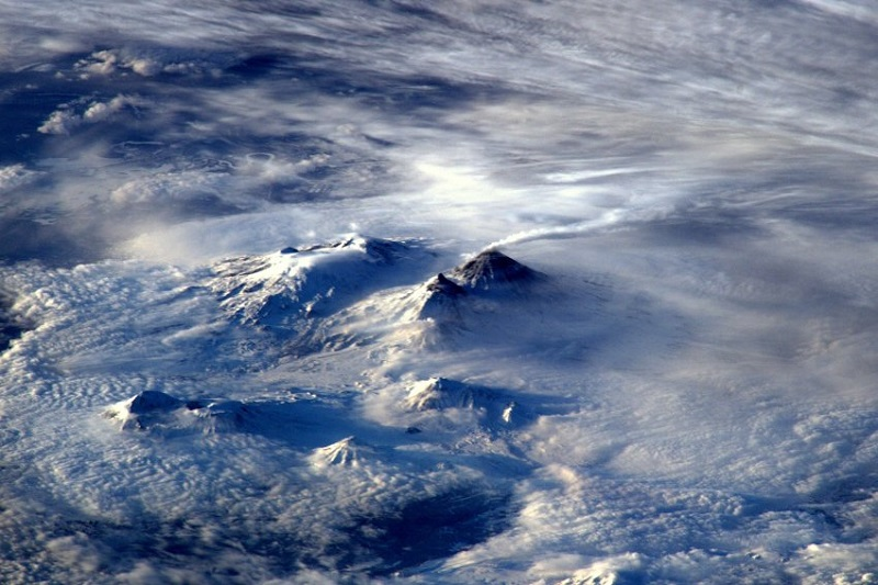 "ESA astronaut Tim Peake took this image from the International Space Station during his six-month Principia mission. He commented: ""Spotted volcano smoking away on Russia's far east coast this morning â heat has melted snow around top.""Professional photographer Max Alexander has known Tim Peake from before his launch into space and gave Tim photography tips during his mission. Max comments: ""Volcanic ash seems to merge into the clouds in this majestic scene from Russia's east coast â with the snow melting around the mountaintop. Low raking light gives form to this monochromatic cloudscape."""