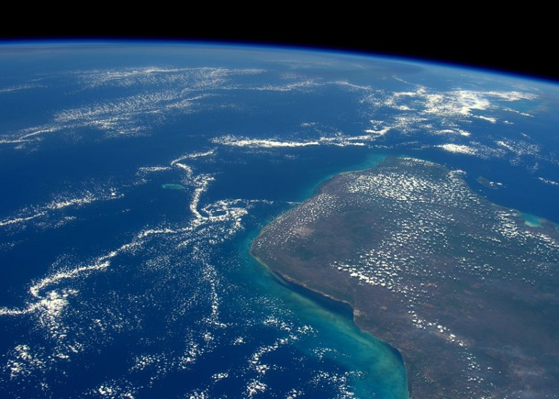 "ESA astronaut Tim Peake took this image from the International Space Station during his six-month Principia mission. He commented: ""66 million years ago a 14-km wide asteroid struck this part of Mexico and wiped out the dinosaurs.""Professional photographer Max Alexander has known Tim Peake from before his launch into space and gave Tim photography tips during his mission. Max comments: ""Tim really scored a bull's eye with this shot of the Yucatan Peninsula, which would have required quite a bit of planning for a favourable orbit. When 66 million years ago, a city-sized asteroid collided with the Earth, right in the middle of the photograph, it wiped out the dinosaurs and 75% of life on Earth. You can imagine an asteroid coming from space and hitting the Earth in this photograph. I asked Tim to take this picture while an offshore scientific expedition was drilling into the submerged impact crater, and also for Asteroid Day â an annual global event on June 30th that raises awareness about the threat of asteroids â which is in partnership with ESA. """