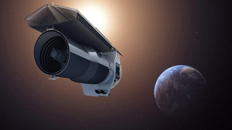 """Художествено изображение на космическия телескоп Спицър. Апаратът обикаля около Слънцето заедно със Земята от 2003 г насам. Спицър """"вижда"""" инфрачервеното лъчение."""